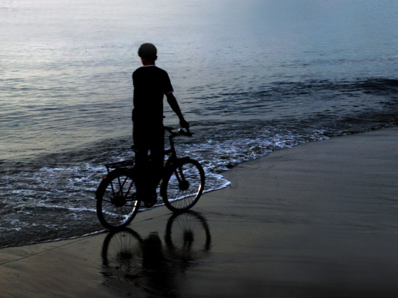 Cycler On a beachside - Untouched by sea