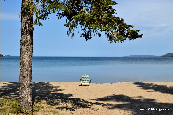 Adirondack chair in front of the lake