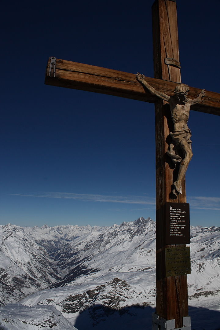 Crucifix overlooking mountains in Switzerland.
