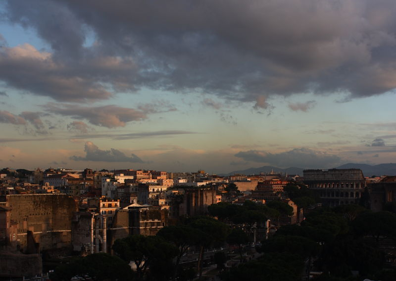 Sunset over the Coliseum in Rome, Italy.