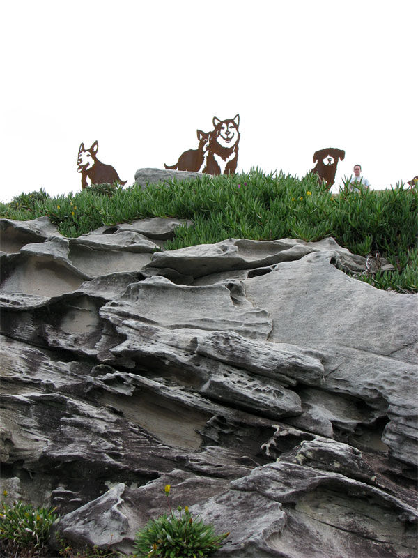 Dog sculptures by the sea