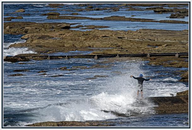Fisherman against waves