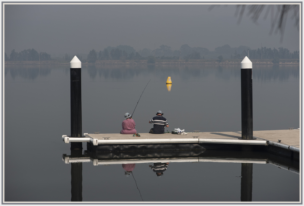 fishing in a smoggy morning