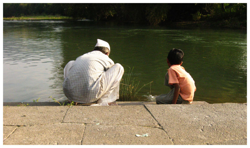 granfather/son duo fishing in the wai river