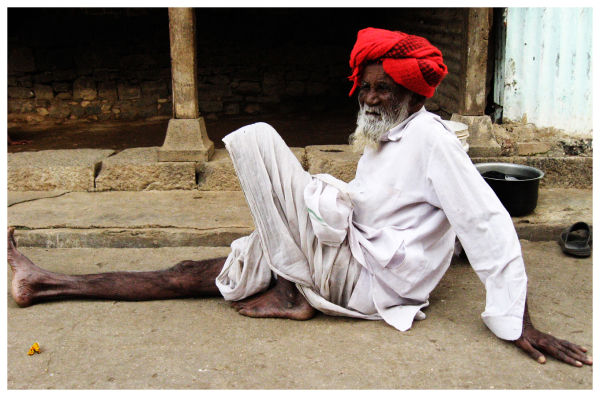 an old man lazying around in wai