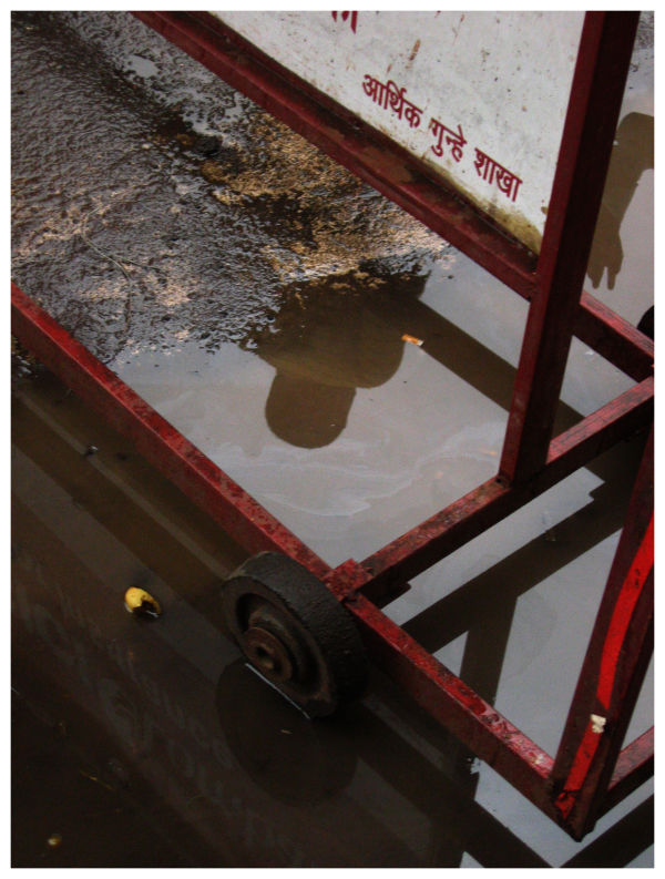 reflection on a puddle on a pune street