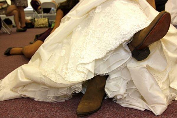 Bride in her wedding boots