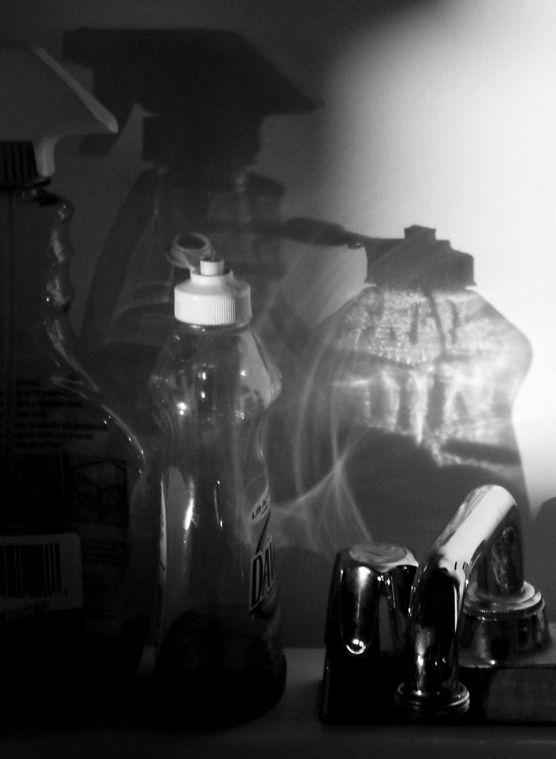 photo of bottles and water faucet.