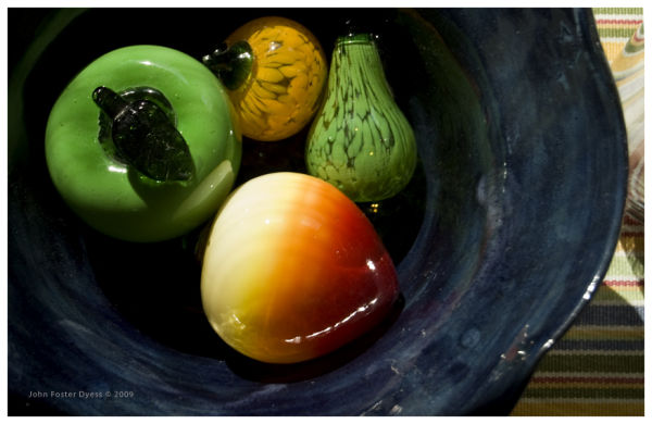Glass fruit in glass bowl