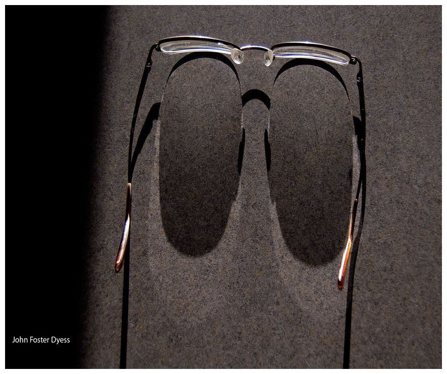 photograph of sun shining on vision glasses