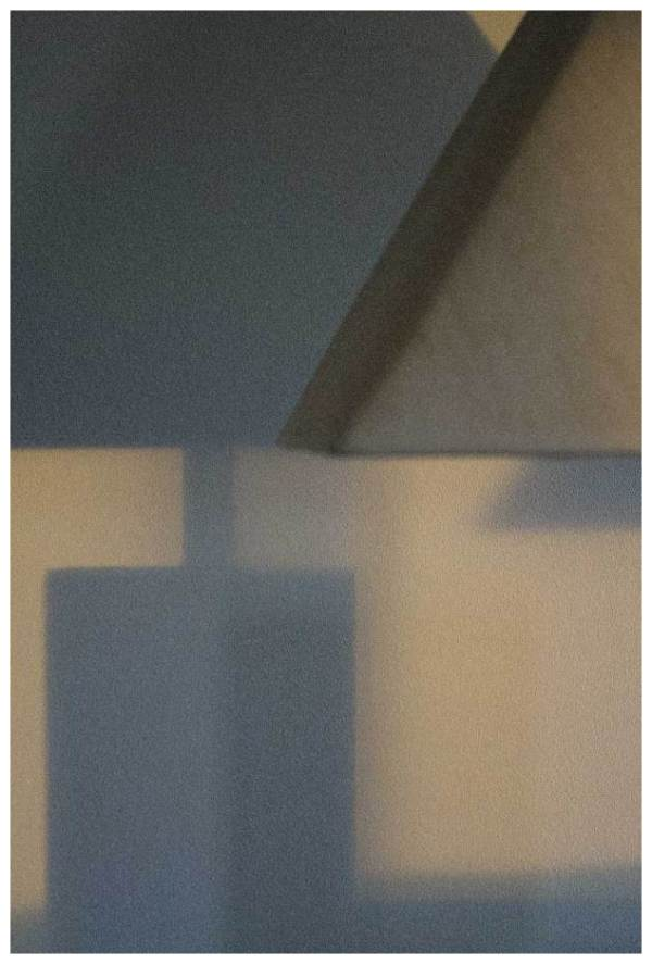 photograph of a lamp and it's shadow
