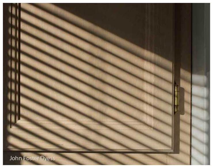 photograph of a kitchen cabinet and blind shadows