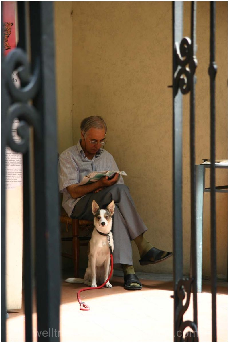 A caretaker and his dog in Florence
