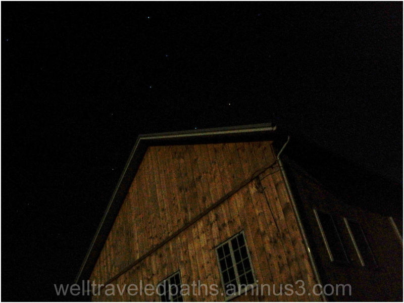 A very bright moon, barn, and the big dipper