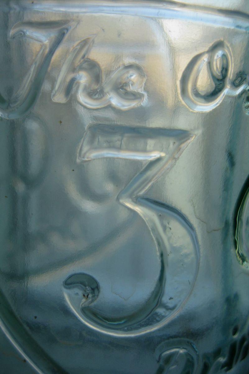 close up of 3 cent coke bottle