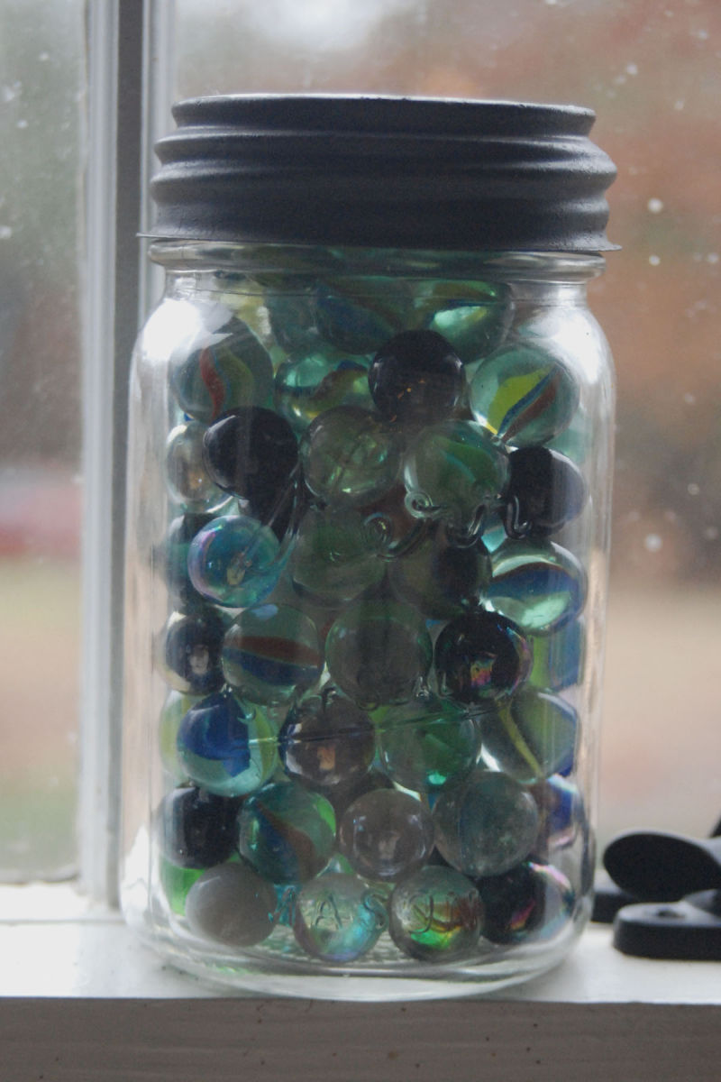 old Mason jar filled with marbles