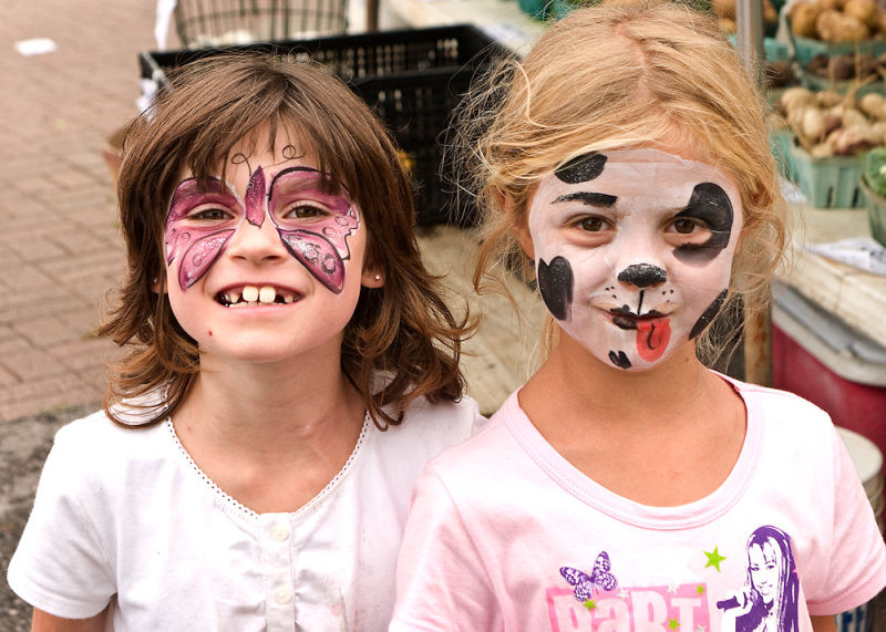 girls eager to show off thier painted faces