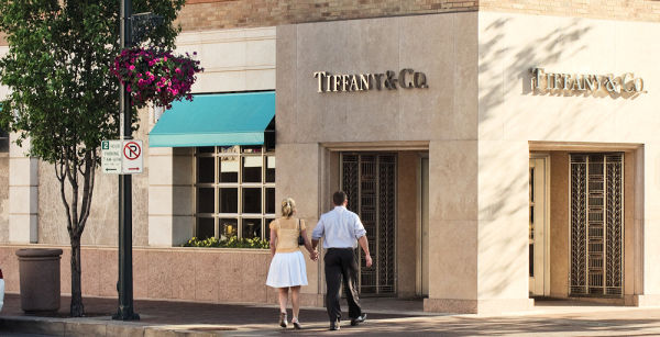couple making way to tiffany store on plaza