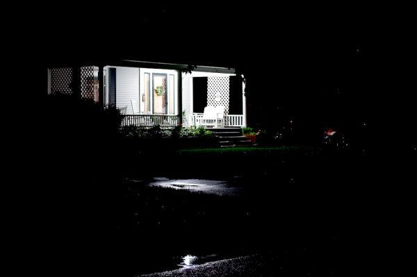 well lit front porch on dark night