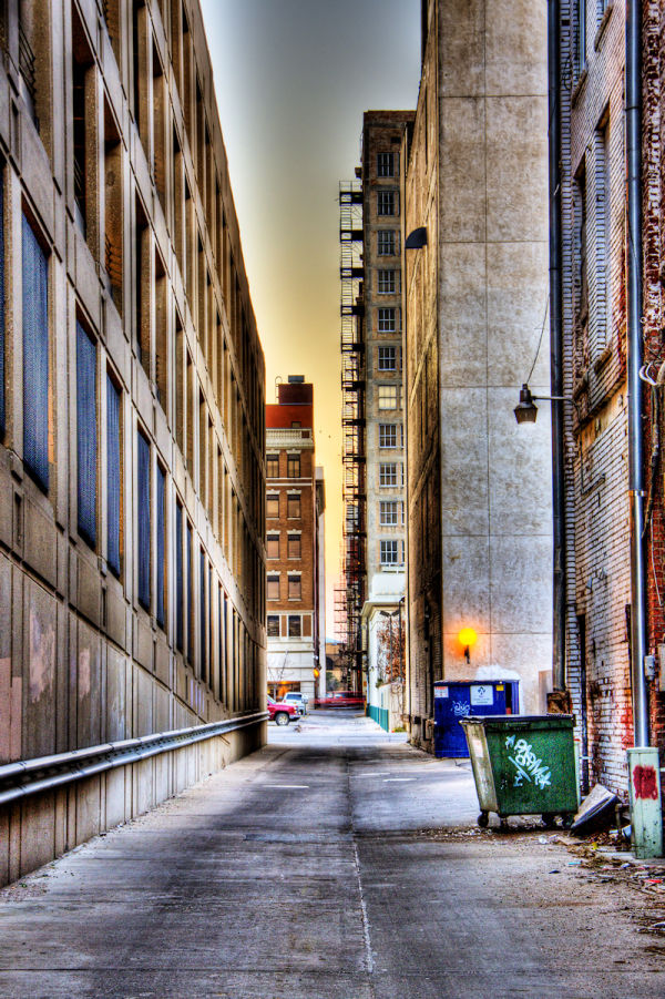 view up downtown alley near sunset