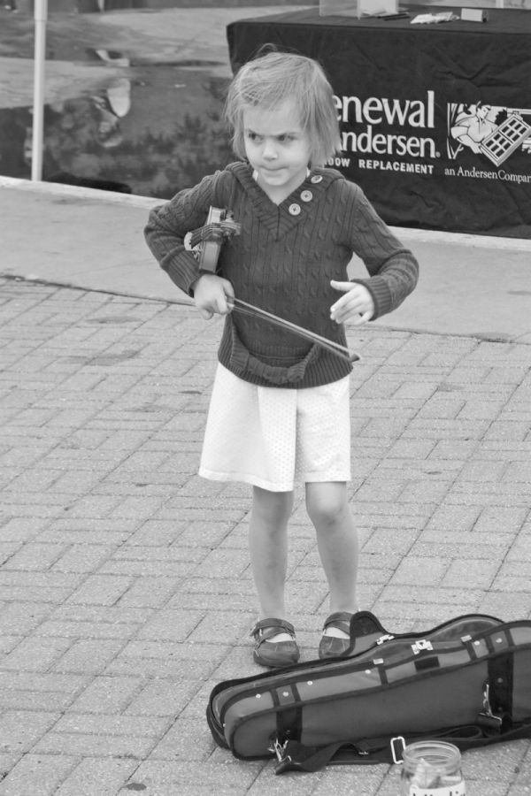 young busker in the kansas city city market