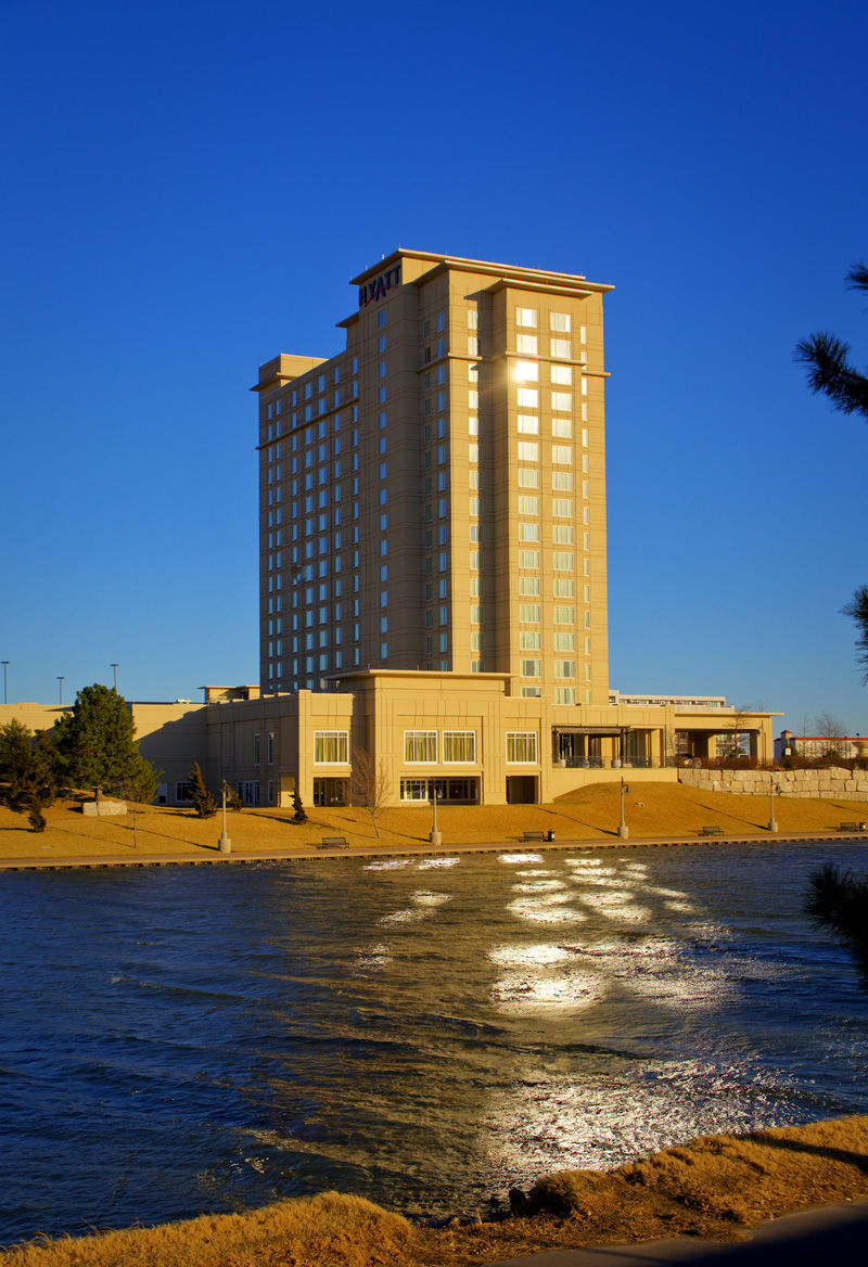 hyatt hotel reflecting on rough water of arkansas