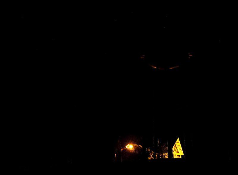 looks like ufo hovering over log cabin
