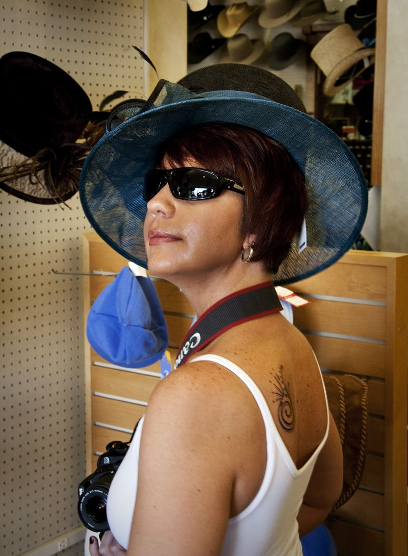 woman trying on hat