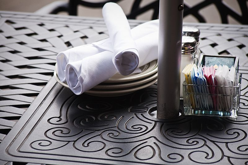 napkins and condiments on table on the plaza
