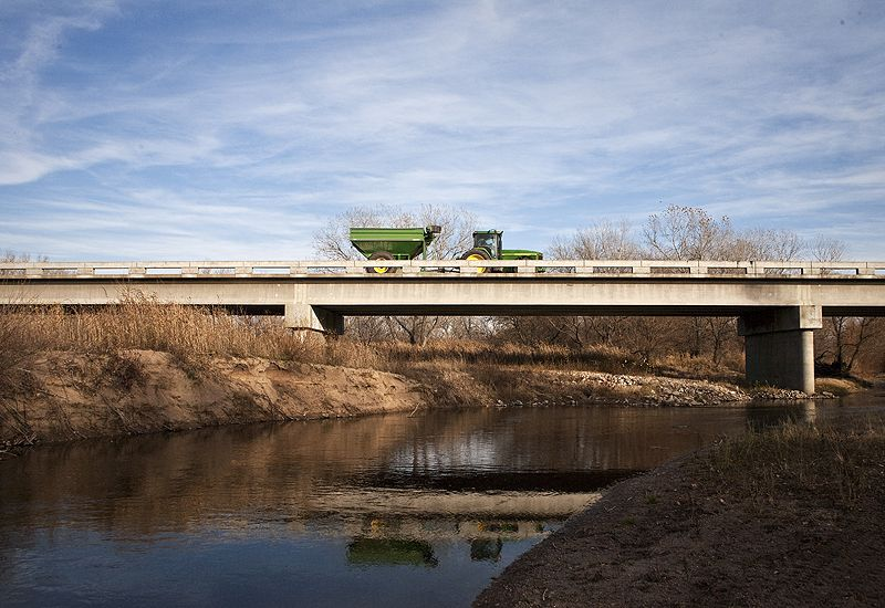 farm equipment crossing bridge