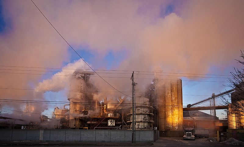 steam on a cold morning takes on sunrise color
