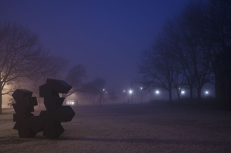 sculpture in the foggy night