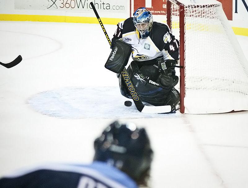 goalie watching the puck near the net