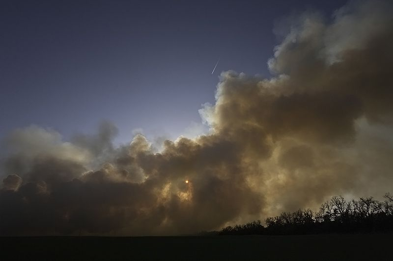 smoke rises from burning off pasture