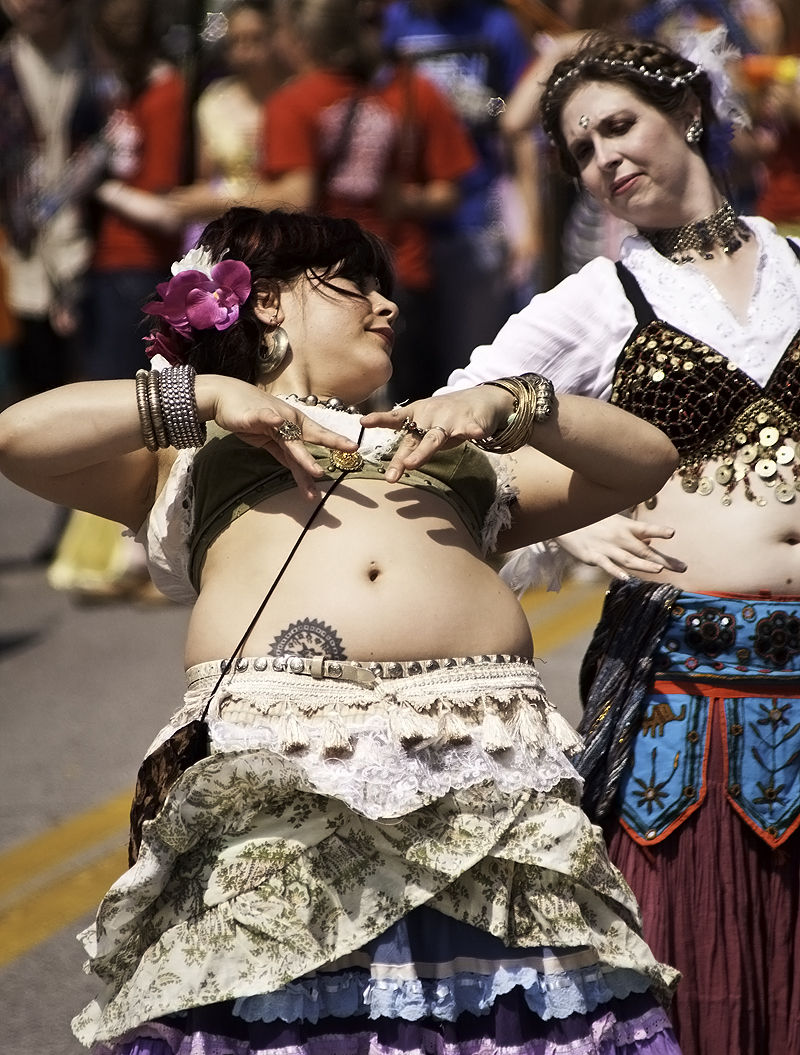 belly dancers marching in arts parade