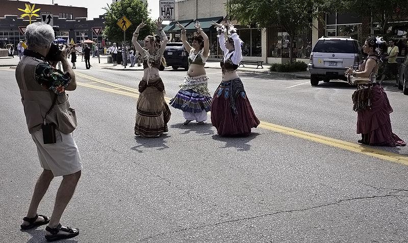 photographer shooting belly dancers at art parade