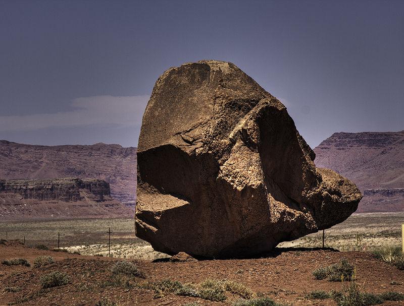 boulder below the cliffs