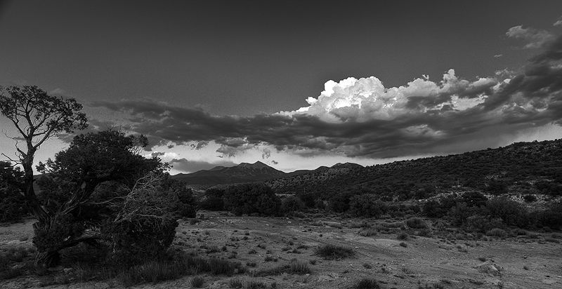 sun lights clouds over utah mountains (blackwhite)