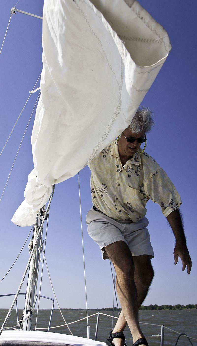 man on deck of sailboat on el dorado lake