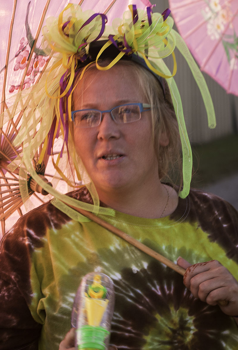 woman selling parasols at the fair