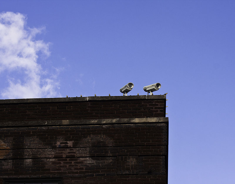 cameras on the roof of an old building