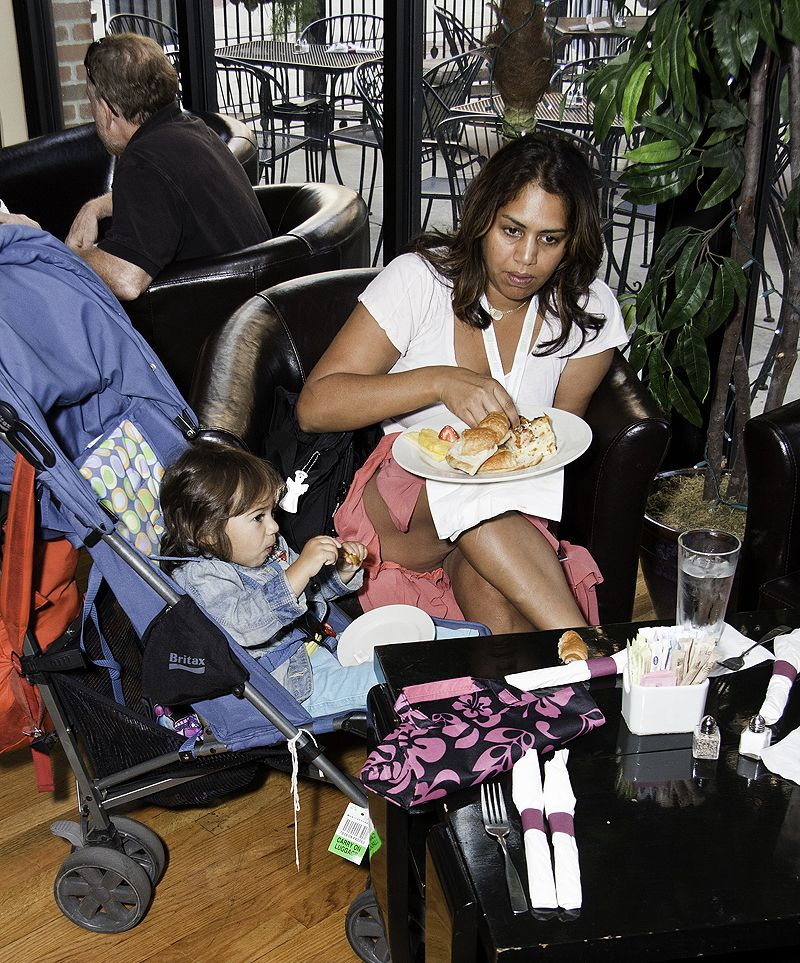 mother and child share breakfast in cafe