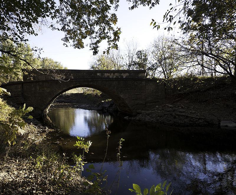 old stone bridge in fall