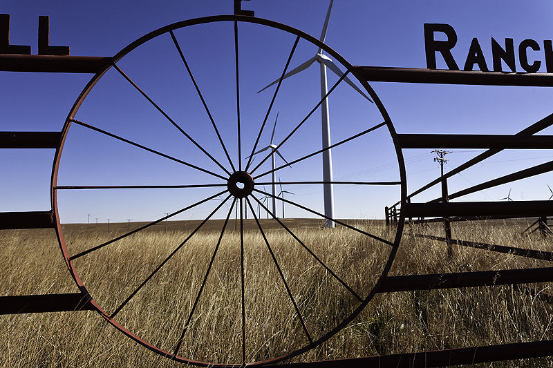 windmills through fence with cattle guard