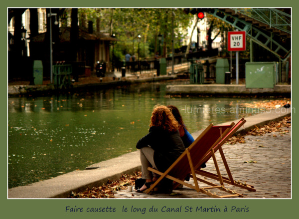 Chatting along the canal Saint Martin in Paris