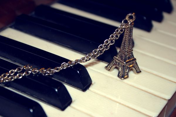 eiffel tower necklace on piano