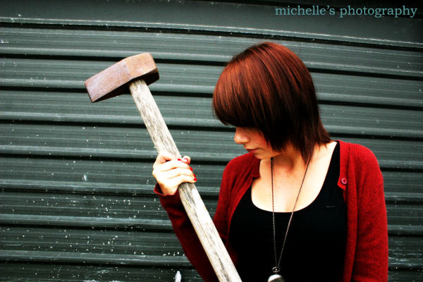 girl holding an axe