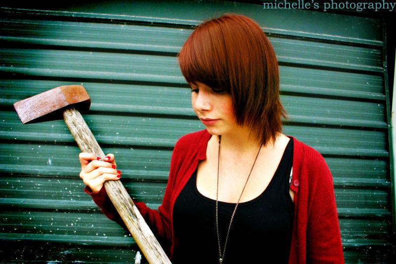 girl holding an axe