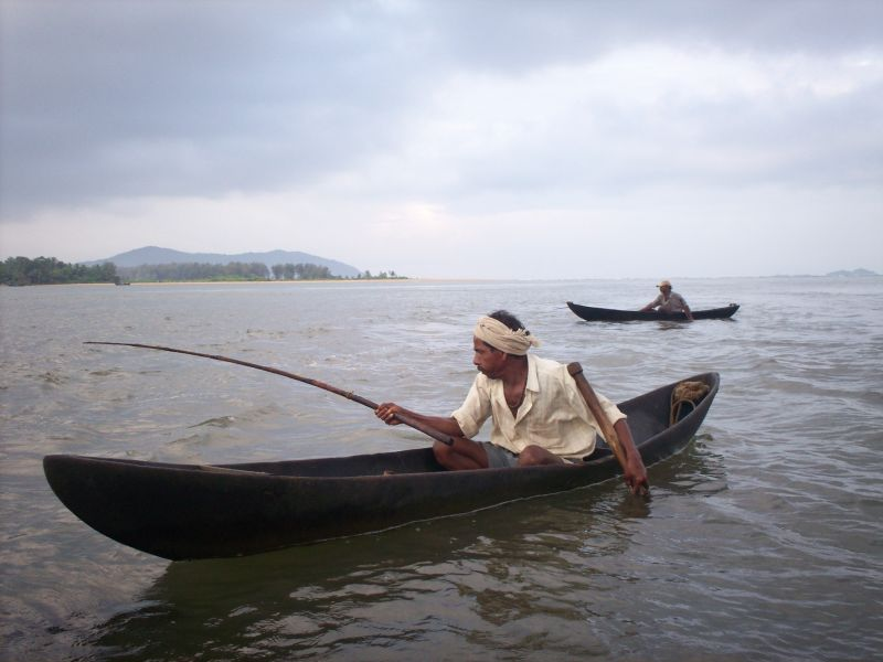 A fisherman concentrating on his work.