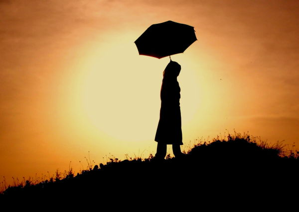 girl with an umbrella in the sunset